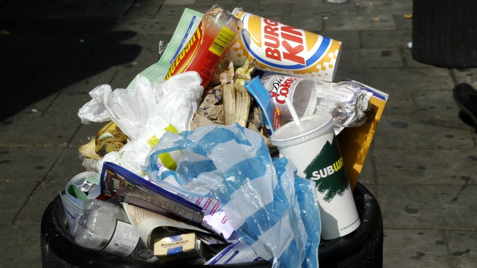 Rubbish overflowing from a bin