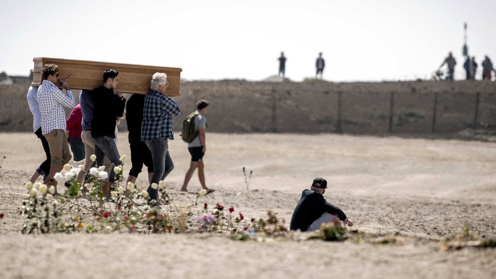 People attend a funeral of Joost and Sander, two of the surfers who died on 11 May, at the beach of Scheveningen, the Netherlands, 18 May 2020