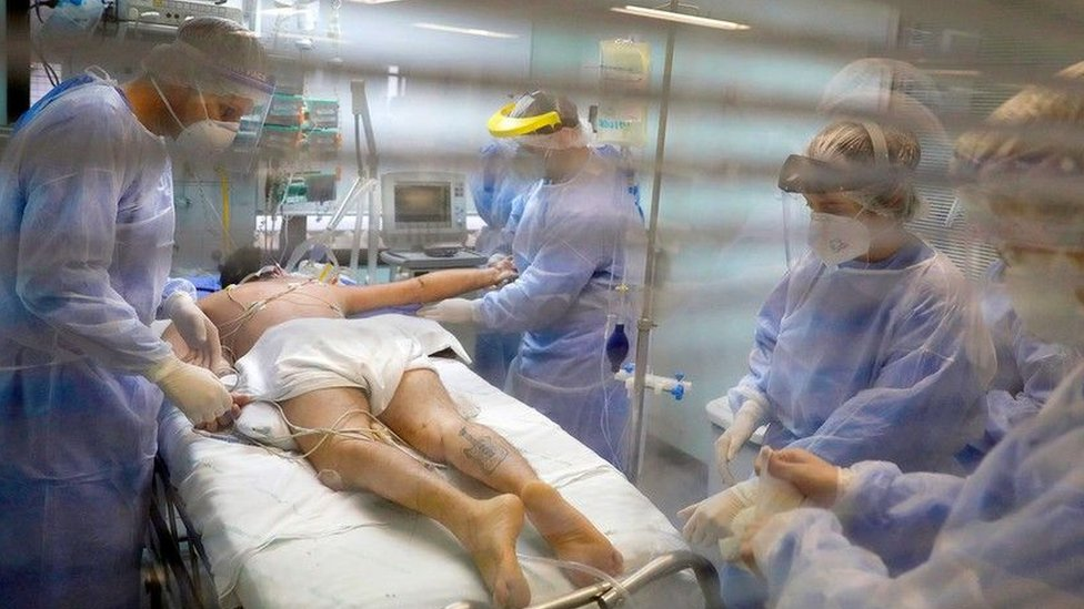 Medical workers care for a Covid-19 patient in Porto Alegre, Brazil