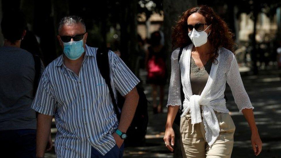People wearing masks in Catalonia