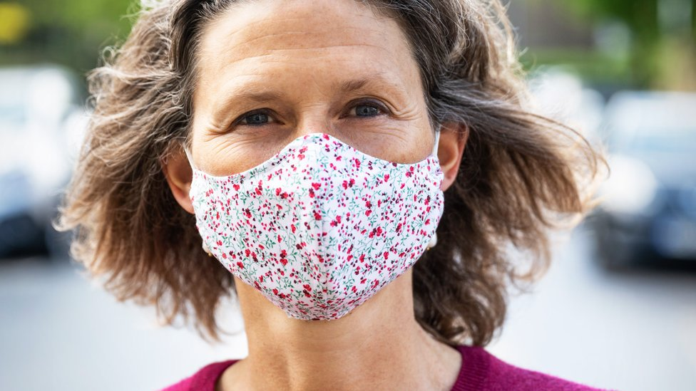 Woman with a homemade face mask