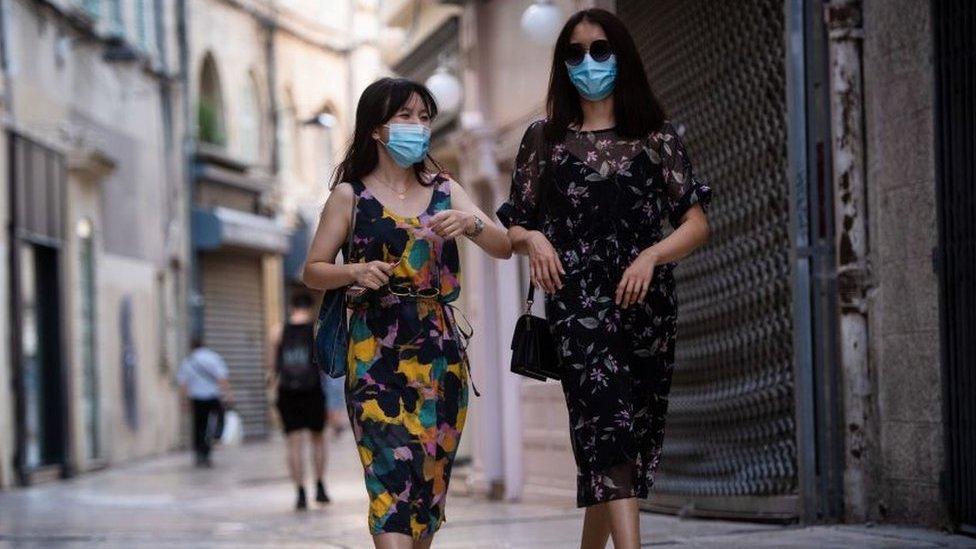 French women walking down the street wearing face masks in Avignon, July 2020