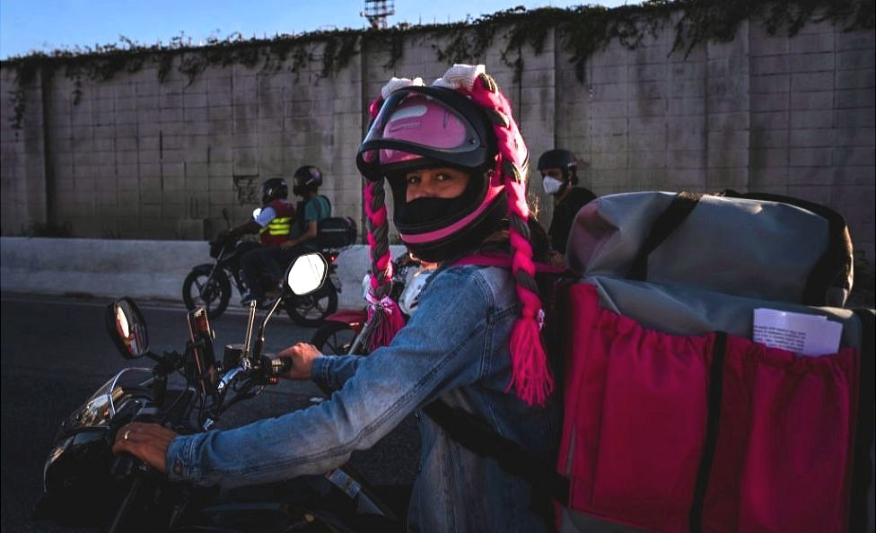 A delivery worker takes part in a demonstration against delivery apps on 25 July, in Belo Horizonte, Brazil