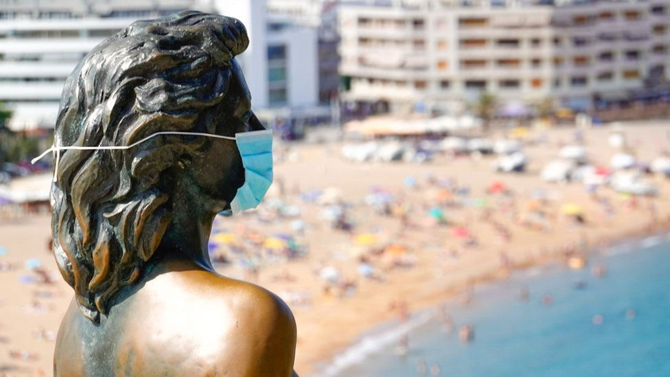 """A view of Ava Gardner""""s statue wearing a protective face mask in Girona, Spain"""