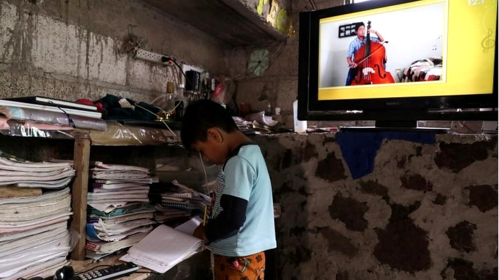 Oscar Hernandez, 5, follows a televised class at home as millions of students returned to classes virtually after schools were ordered into lockdown in March, due to the coronavirus disease (COVID-19) outbreak, in Chilcuautla, Hildalgo state, Mexico August 24, 2020.