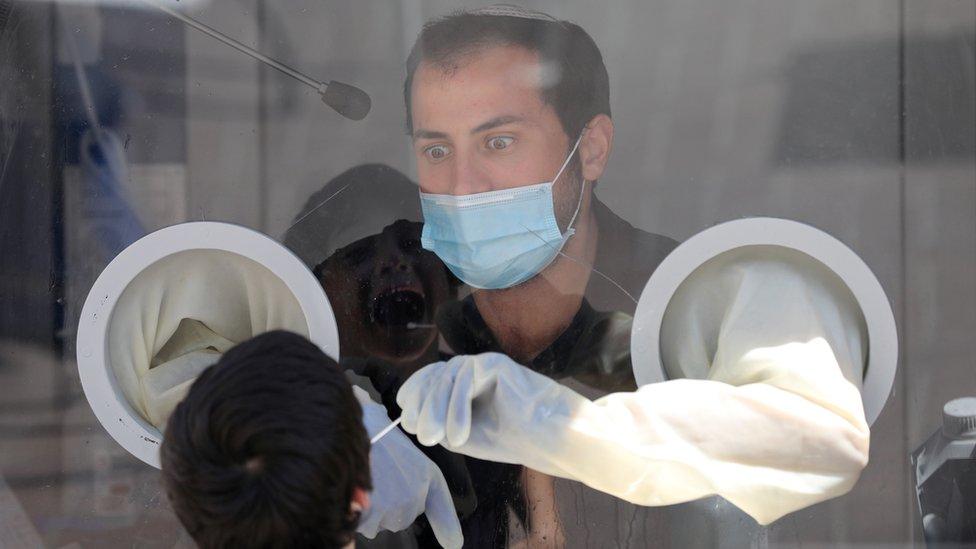 "Medical team of Maccabi Health Services takes swab samples at a test station in Modi""in near Jerusalem, Israel, 13 September 2020"