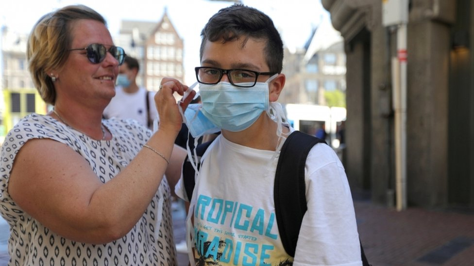 Residents in the Netherland's three largest cities will be told to wear masks in shops from Tuesday