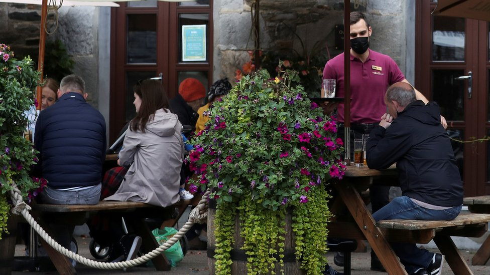 People drinking outside a pub