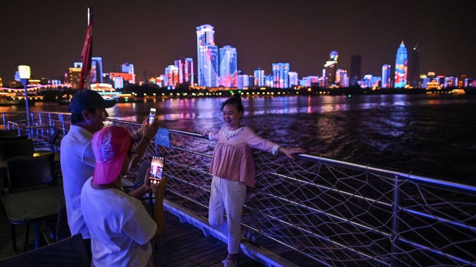 Tourists at the riverfront in Wuhan