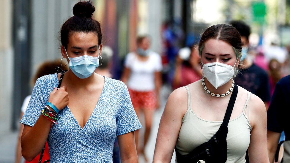 People wear protective masks in the streets of Madrid, Spain, 28 July 2020