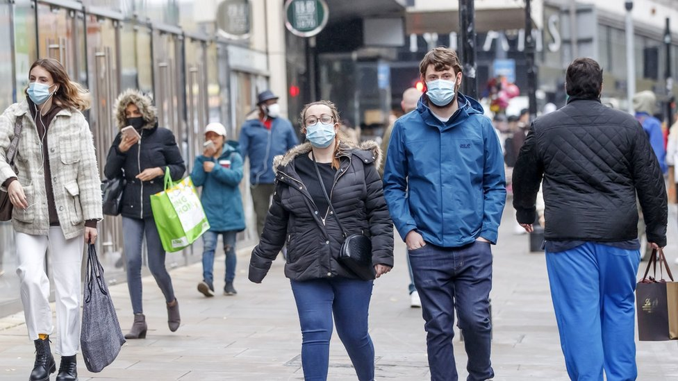 People wear face coverings in Manchester City Centre