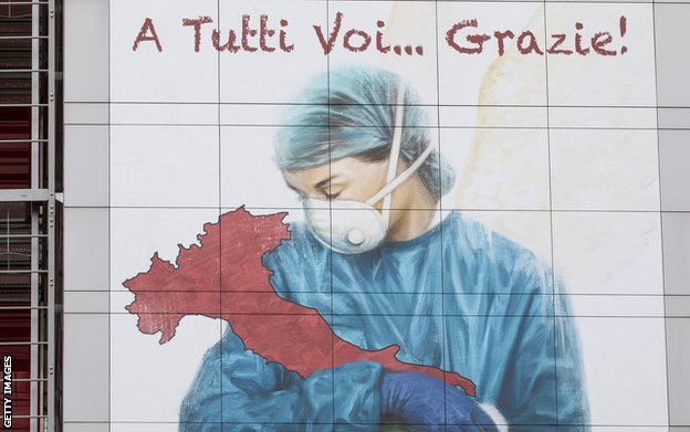 A mural dedicated to Italian medical workers depicts a nurse cradling Italy and reads: 'To All Of You... Thank You!', on a wall of Papa Giovanni XXIII Hospital on March 25, 2020 in Bergamo