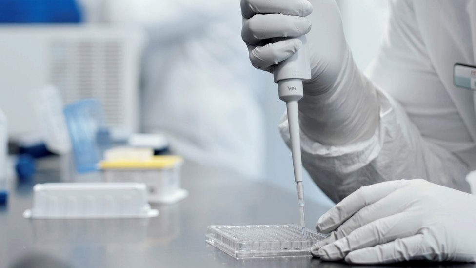A researcher works in a lab run by Moderna Inc