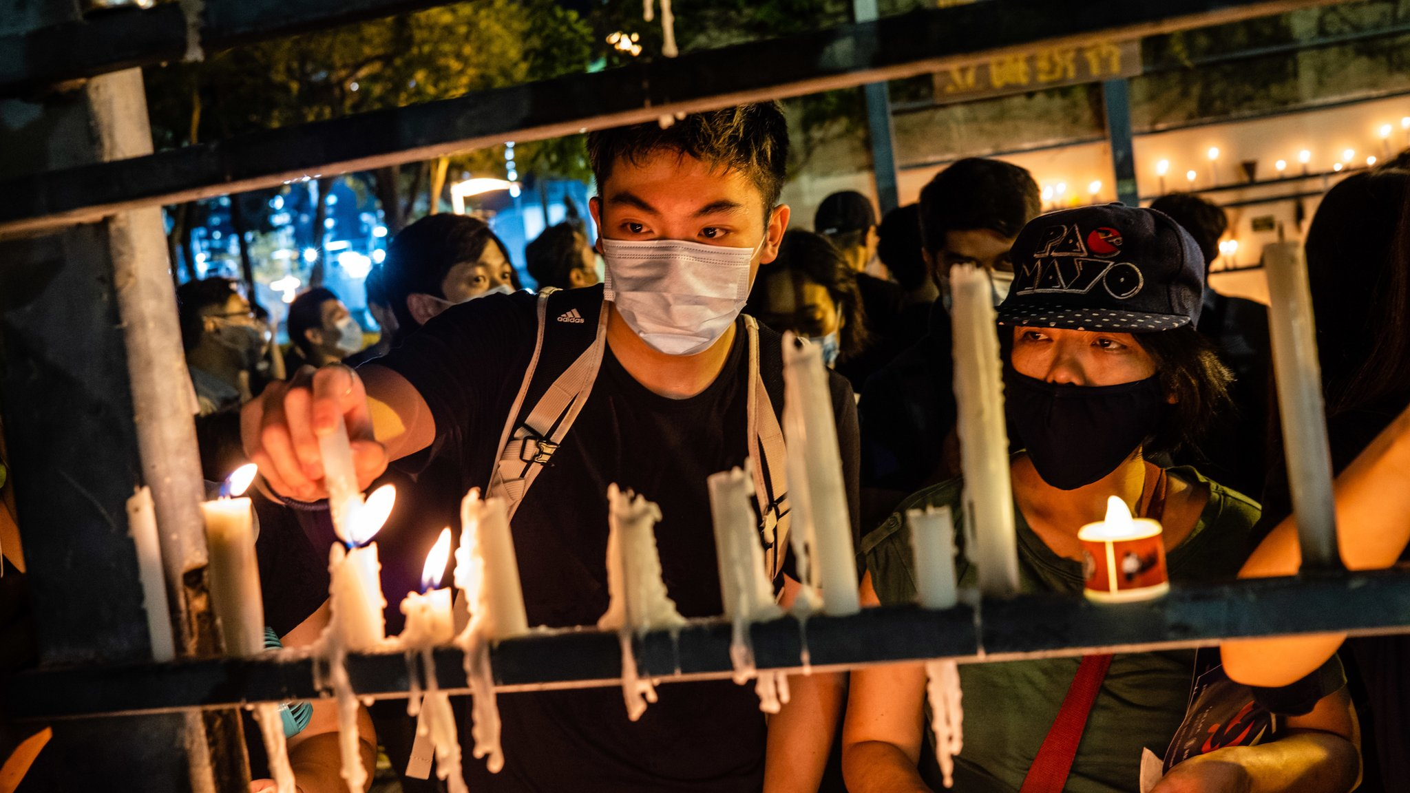 Protesters light candles during the 31st anniversary of the Tiananmen Massacre. Thousands gathered for the annual memorial vigil in Victoria Park to mark the 1989 Tiananmen Square Massacre despite a police ban citing coronavirus social distancing restrictions.