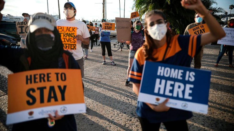 People hold signs during a rally in support of the Supreme Court's ruling in favor of the Deferred Action for Childhood Arrivals programme in San Diego, California