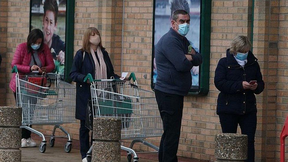Shoppers outside Morrisons