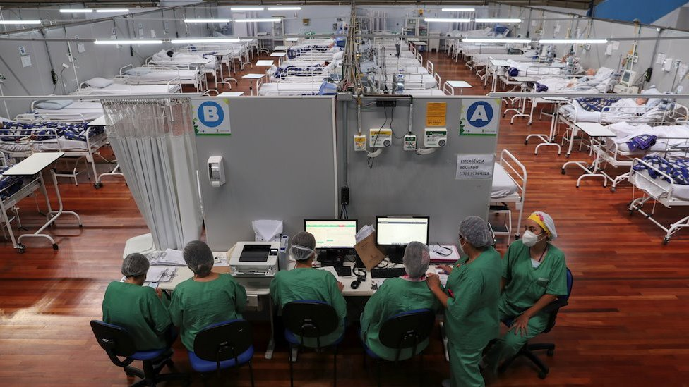 Nurses work during New Year's Eve at a field hospital set up at a sports gym to treat patients suffering with the coronavirus disease (COVID-19) in Santo Andre, Sao Paulo state, Brazil, December 31, 2020.