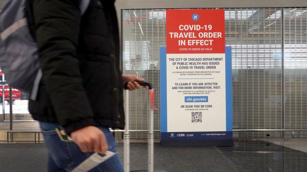 A traveller passes through O'Hare International Airport
