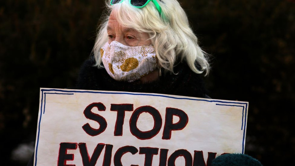 A demonstrator carried a simple message. Boston tenants, faith leaders, and small landlords rallied and marched, calling for a stronger, longer federal eviction ban