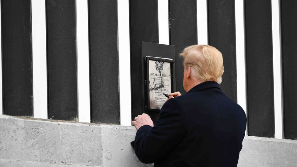 US President Donald Trump tours and signs a section of the border wall in Alamo, Texas