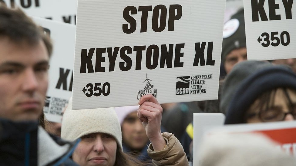 Opponents of the Keystone XL and Dakota Access pipelines hold a rally as they protest Donald Trump's executive orders advancing their construction in 2017