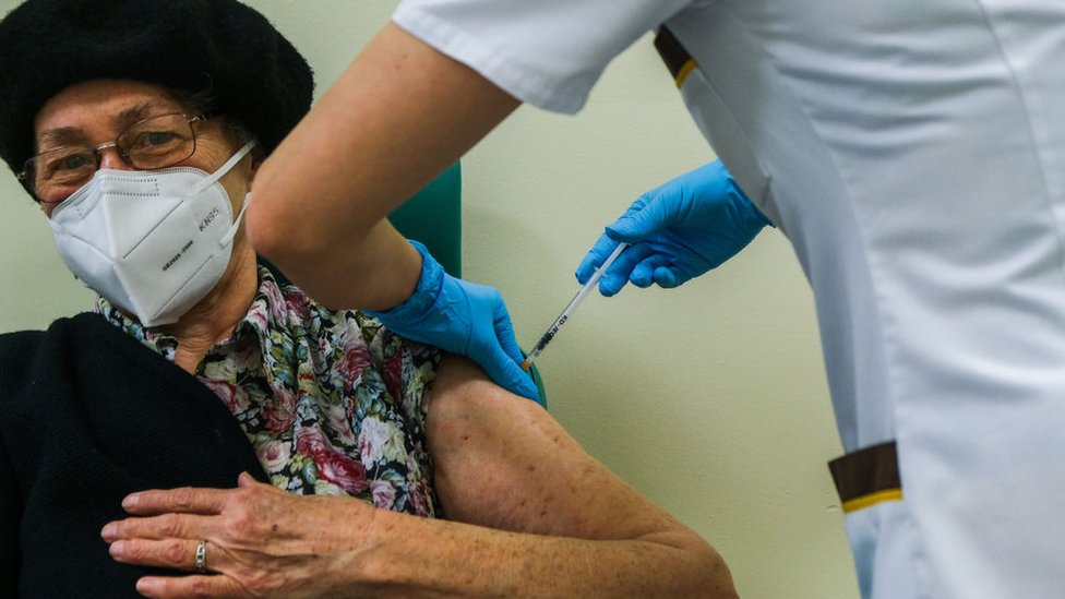 A patient receiving a vaccine in the UK