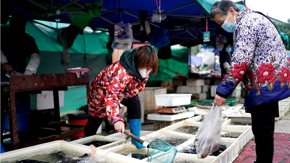 Vendors are selling fish in an open market in Wuhan, Hubei province, China, 2 December 2020