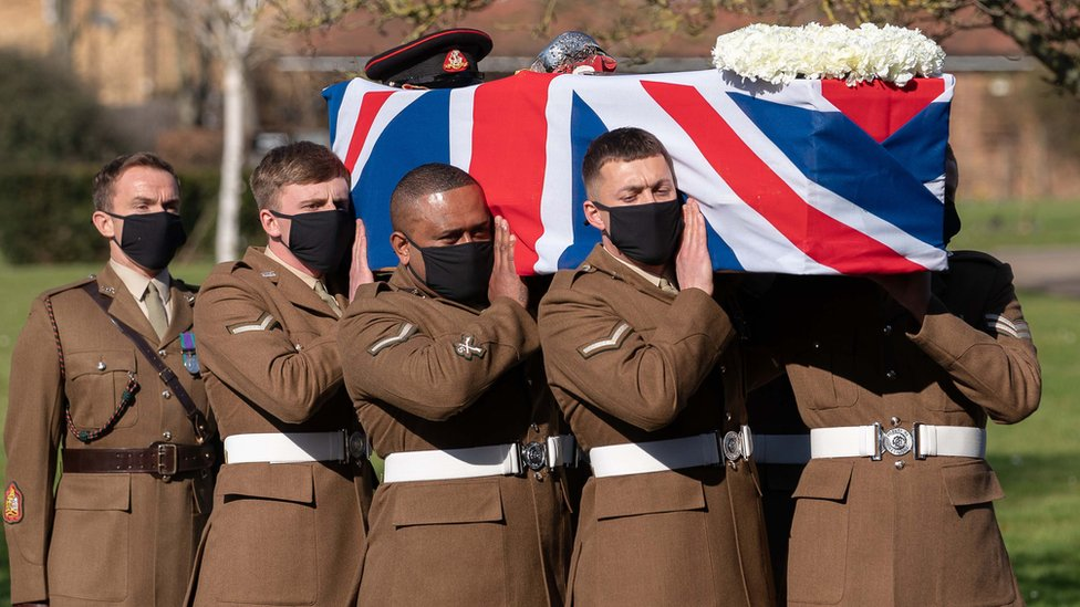 Members of the Yorkshire Regiment carry Captain Sir Tom Moore's coffin