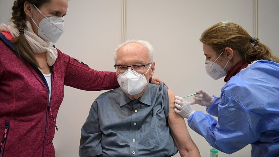 Werner Boestfleisch, 86, receives a dose of the Pfizer-BioNTech vaccine at the Metropolis-Halle vaccination centre in Potsdam, Germany, January 5, 2021