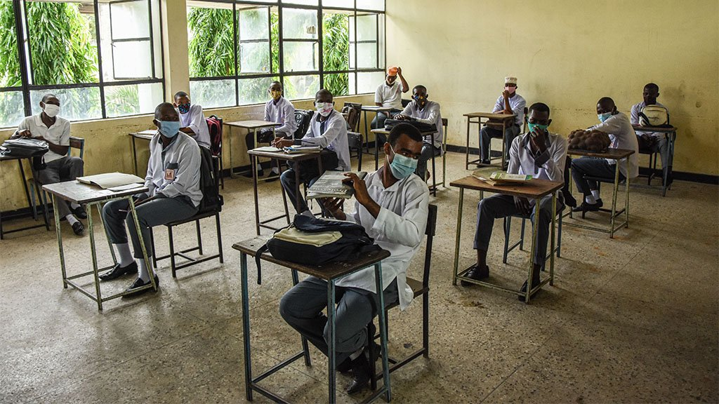 Students of Al-Haramain secondary school wait for their class to start as they attend their first day of re-opened school in Dar es Salaam, Tanzania, on June 1, 2020.