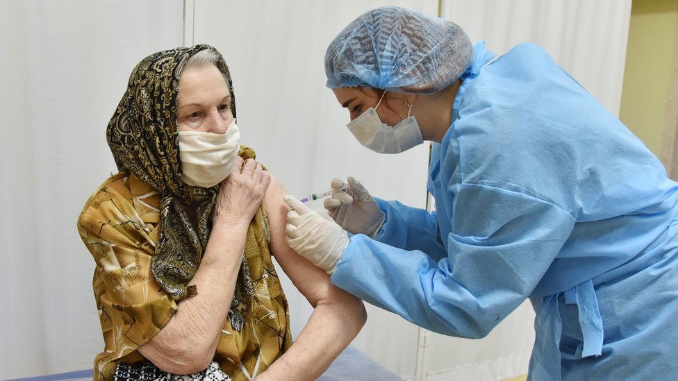 A woman is vaccinated in Ukraine