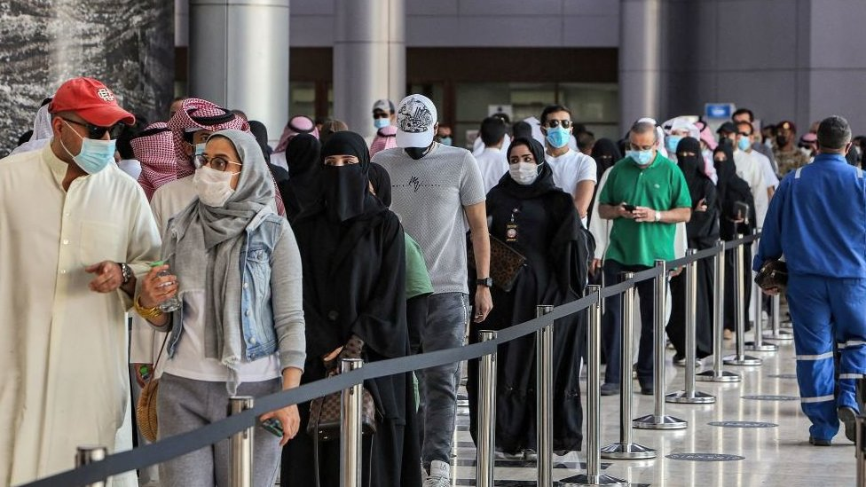 Queues at a vaccine centre in Kuwait