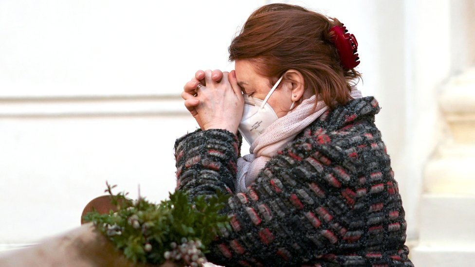 A worshipper attends a Palm Sunday mass, amid the coronavirus disease (COVID-19) outbreak, in Warsaw, Poland March 28, 2021