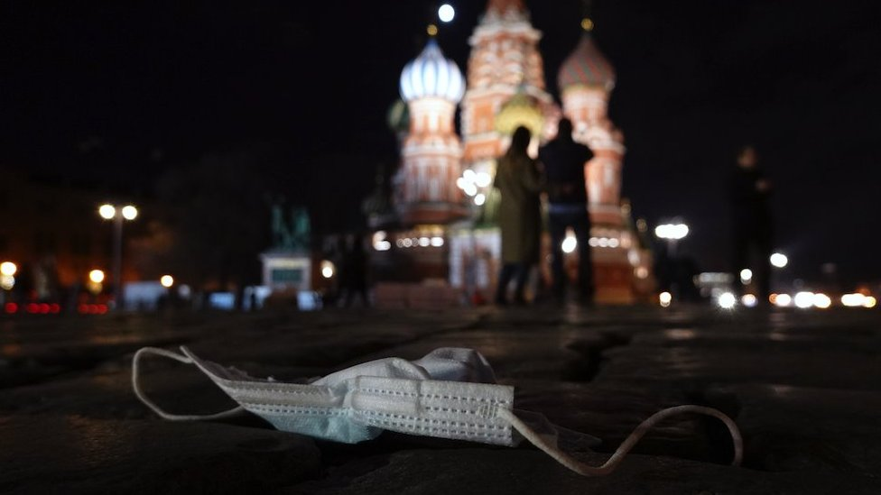 A discarded protective face mask lies on the Red Square in Moscow, Russia, 27 March 2021