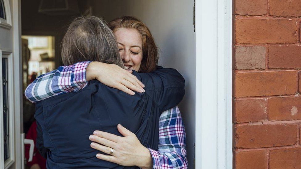 A single mother hugs her mother and shares a tender bonding moment with each other.