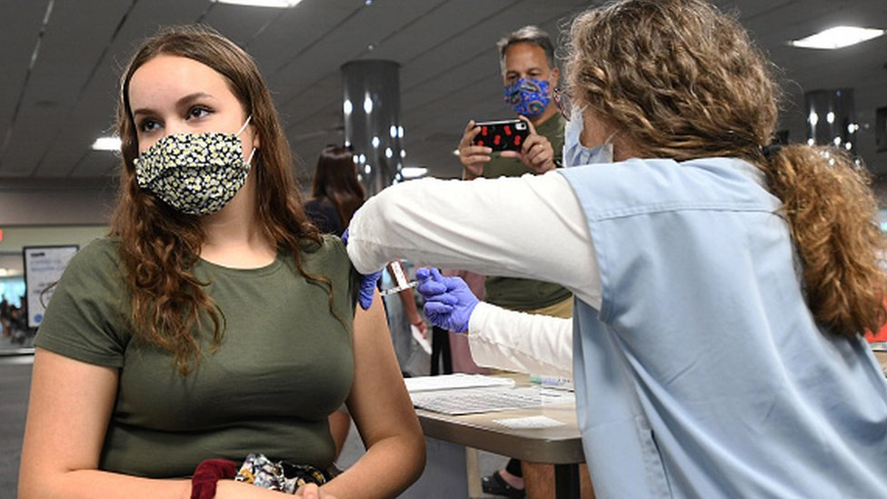 A nurse gives Sherri Trimble, 15, a shot of the vaccine at a vaccination clinic in Florida