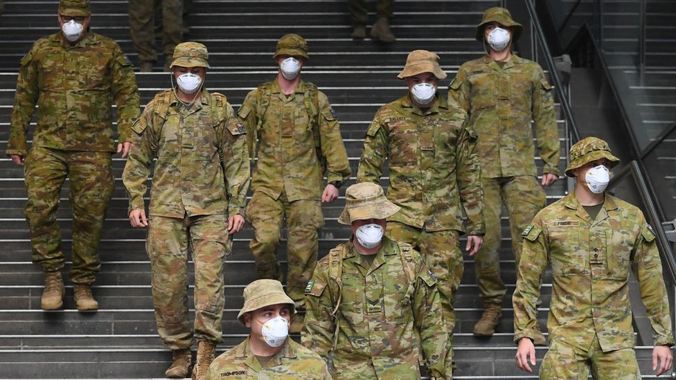 Australian Defence Force soldiers walk through the city during Melbourne's lockdown last year.